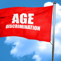 red waving flag with age discrimination caption on it