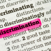 Paper that reads discrimination