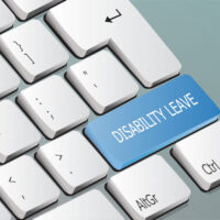 Disability Leave written on the keyboard button